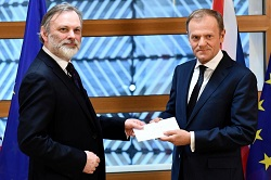 Sir Tim Barrow hands letter to Donald Tusk