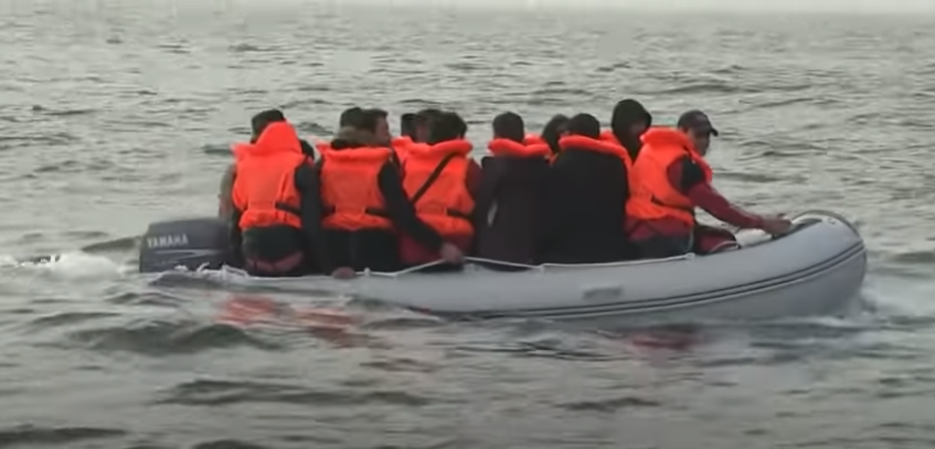 Migrants in dinghy crossing the English Channel
